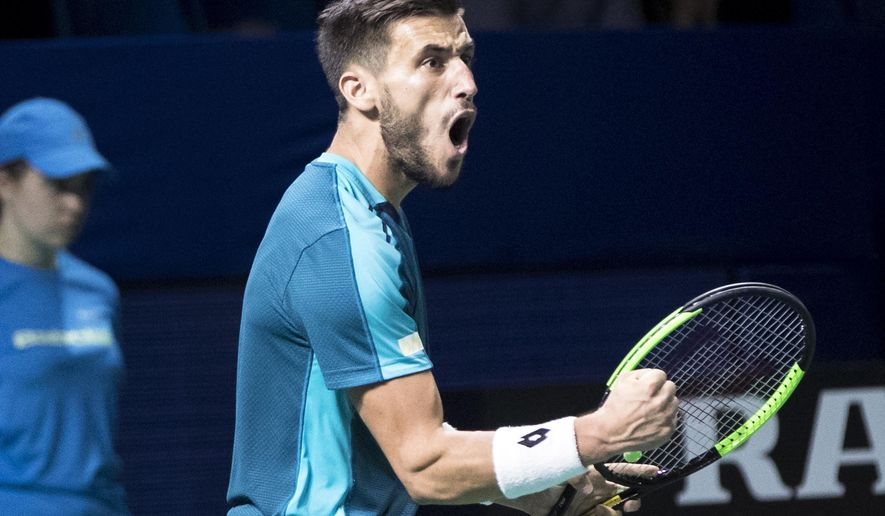Damir Dzumhur of Bosnia and Herzegovina reacts after winning a point against Ricardas Berankis of Lithuania during the final match at the Kremlin Cup tennis tournament in Moscow, Russia, Sunday, Oct. 22, 2017. (AP Photo/Pavel Golovkin)