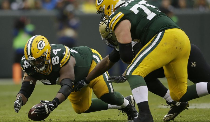 Green Bay Packers offensive tackle Justin McCray (64) recovers a fumble by the Packers quarterback Brett Hundley during the second half of an NFL football game against the New Orleans Saints, Sunday, Oct. 22, 2017, in Green Bay, Wis. (AP Photo/Jeffrey Phelps)