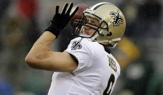 New Orleans Saints quarterback Drew Brees (9) warms up before an NFL football game against the Green Bay Packers, Sunday, Oct. 22, 2017, in Green Bay, Wis. (AP Photo/Jeffrey Phelps)