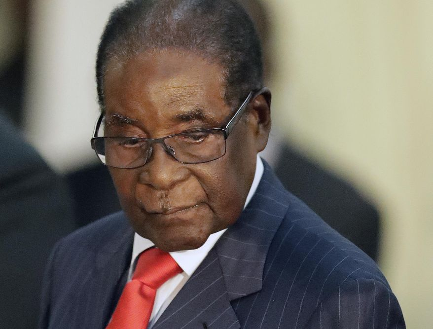 In this file photo dated Tuesday, Oct. 3, 2017, Zimbabwean President Robert Mugabe during his meeting with South African President Jacob Zuma, at the Presidential Guesthouse in Pretoria, South Africa. (AP Photo/Themba Hadebe, FILE)