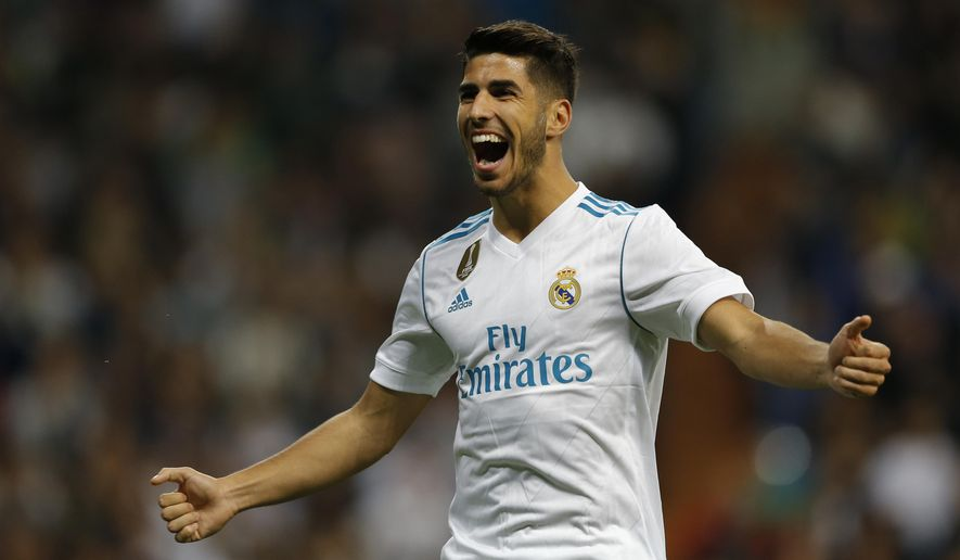 Real Madrid's Marco Asensio celebrates after scoring his side's second goal against Eibar during the Spanish La Liga soccer match between Real Madrid and Eibar at the Santiago Bernabeu stadium in Madrid, Sunday, Oct. 22, 2017. (AP Photo/Francisco Seco)