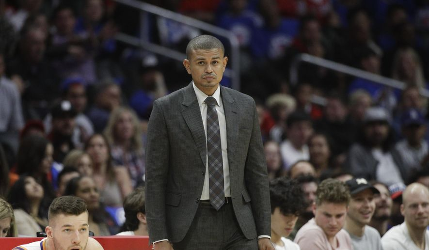 In this Oct. 21, 2017, photo, Phoenix Suns head coach Earl Watson watches action during the second half of an NBA basketball game against the Los Angeles Clippers in Los Angeles. The Suns have fired coach Watson just three games in to the NBA season. Phoenix announced the firing Sunday night, Oct. 22, after hours of meetings at the team's headquarters. (AP Photo/Jae C. Hong)