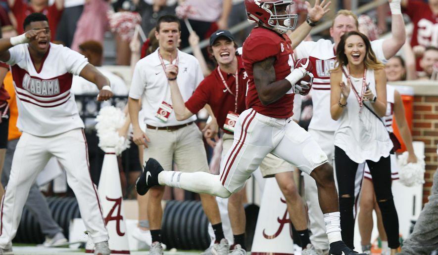Alabama wide receiver Henry Ruggs III scores a touchdown during the second half an NCAA college football game against Tennessee, Saturday, Oct. 21, 2017, in Tuscaloosa, Ala. (AP Photo/Brynn Anderson)