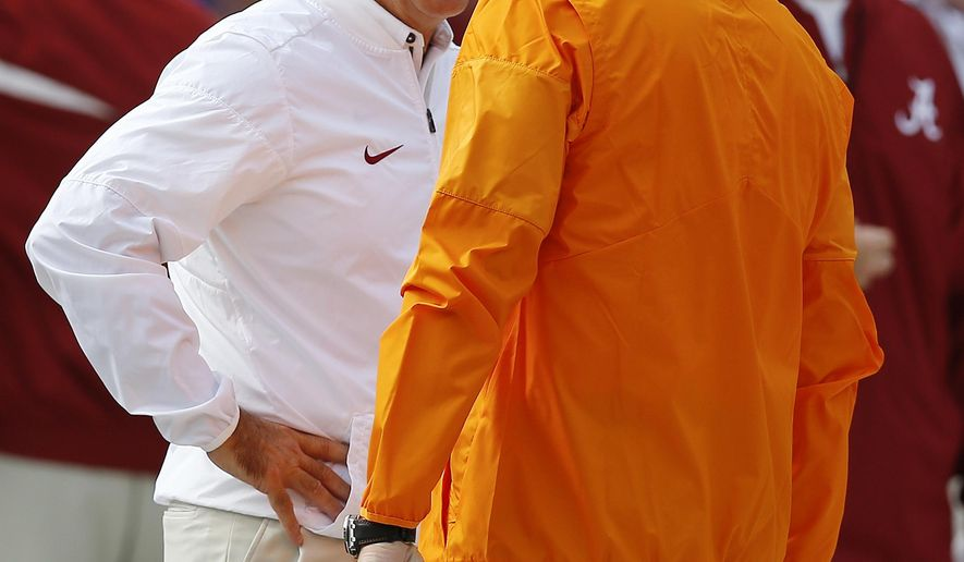 Alabama head coach Nick Saban, left, and Tennessee head coach Butch Jones talk before an NCAA college football game, Saturday, Oct. 21, 2017, in Tuscaloosa, Ala. (AP Photo/Brynn Anderson)