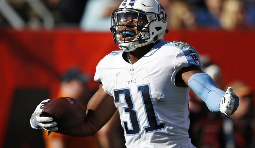 Tennessee Titans free safety Kevin Byard celebrates an interception in the second half of an NFL football game against the Cleveland Browns, Sunday, Oct. 22, 2017, in Cleveland. (AP Photo/Ron Schwane)