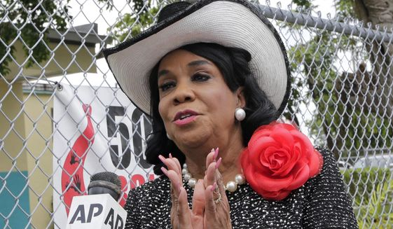 """Rep. Frederica Wilson, D-Fla., talks to reporters, Wednesday, Oct. 18, 2017, in Miami Gardens, Fla. Wilson is standing by her statement that President Donald Trump told Myeshia Johnson, the widow of Sgt. La David Johnson killed in an ambush in Niger, that her husband """"knew what he signed up for."""" In a Wednesday morning tweet, Trump said Wilson's description of the call was """"fabricated."""" (AP Photo/Alan Diaz)"""