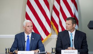 Vice President Mike Pence, left, accompanied by Vice-Chair Kansas Secretary of State Kris Kobach, right, speaks during the first meeting of the Presidential Advisory Commission on Election Integrity at the Eisenhower Executive Office Building on the White House complex in Washington. The information coming out of President Donald Trump's commission to investigate voter fraud has frustrated not only reporters and senators but now even members of the commission. (AP Photo/Andrew Harnik, File)