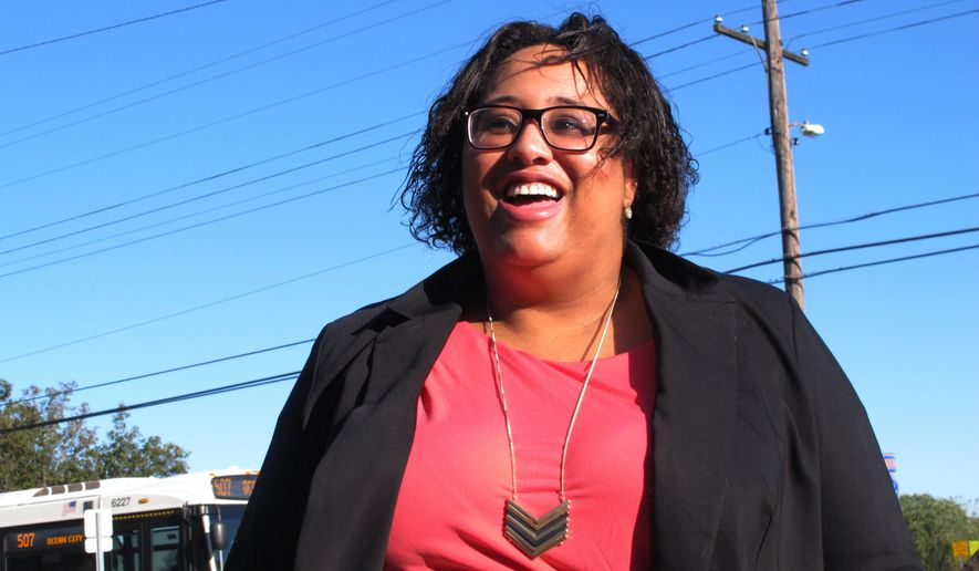 In this Oct. 20, 2017 photo, Ashley Bennett, a Democratic candidate for freeholder in Atlantic County, N.J., speaks about her campaign in Northfield, N.J. She decided to make her first run for public office after an incumbent Republican on the freeholder board posted a meme on social media asking whether participants in the Women's March on Washington would be home in time to cook dinner. (AP Photo/Wayne Parry)