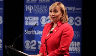 Republican gubernatorial candidate Kim Guadagno is not following the playbook of her boss, Gov. Chris Christie, who won an unlikely re-election campaign in 2012 by specifically reaching out to Hispanics and other minorities in a state that typically votes for Democrats. (Associated Press)