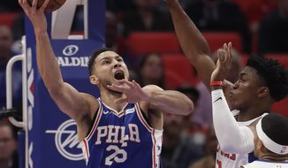 Philadelphia 76ers guard Ben Simmons (25) shoots as Detroit Pistons forward Stanley Johnson, right, defends during the first half of an NBA basketball game, Monday, Oct. 23, 2017, in Detroit. (AP Photo/Carlos Osorio)