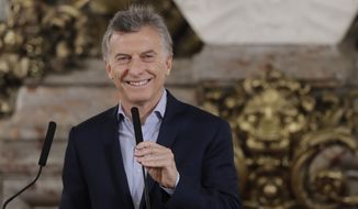Argentina's President Mauricio Macri attends a press conference at the government house in Buenos Aires, Argentina, Monday, Oct. 23, 2017. Macri's governing coalition won strong support in results from Sunday's congressional elections and appeared headed to its first legislative majority since he took office in 2015. (AP Photo/Natacha Pisarenko)