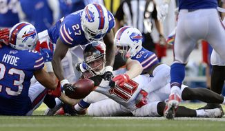 Tampa Bay Buccaneers wide receiver Adam Humphries (10) fumbles the ball during the second half of an NFL football game against the Buffalo Bills, Sunday, Oct. 22, 2017, in Orchard Park, N.Y. The Bills recovered the ball.