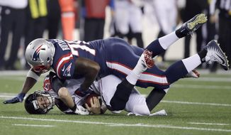 New England Patriots defensive tackle Adam Butler, right, sacks Atlanta Falcons quarterback Matt Ryan during the first half of an NFL football game, Sunday, Oct. 22, 2017, in Foxborough, Mass. (AP Photo/Charles Krupa)