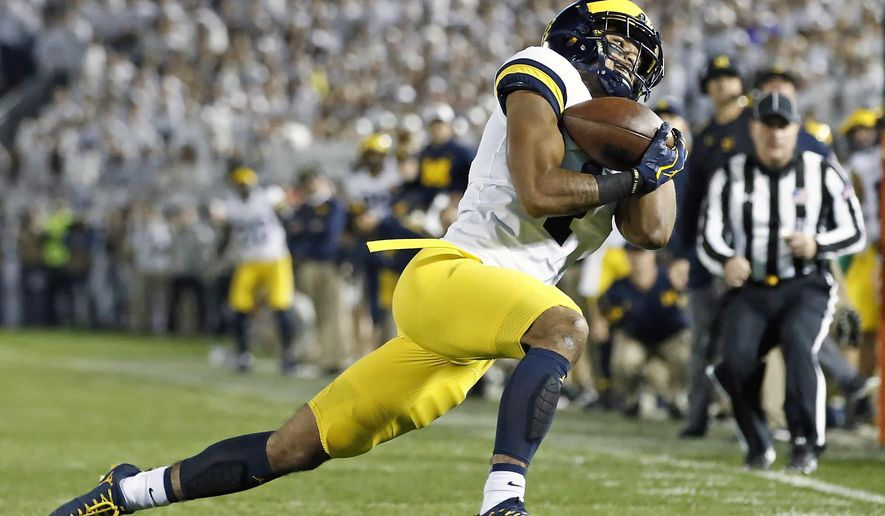 Michigan's Kekoa Crawford (1) hauls in a catch against Penn State during the first half of an NCAA college football game in State College, Pa., Saturday, Oct. 21, 2017. (AP Photo/Chris Knight)