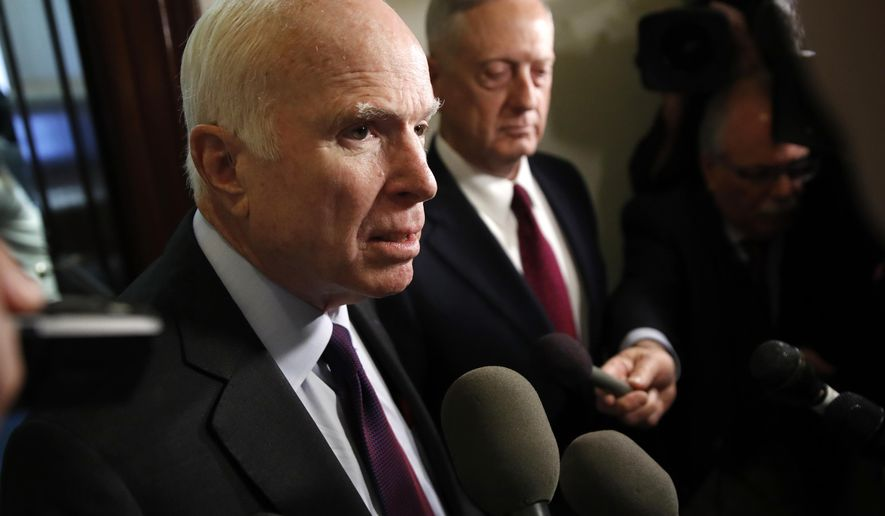Sen. John McCain, R-Ariz., left, and Defense Secretary James Mattis, speak to members of the media after their meeting Friday, Oct. 20, 2017, on Capitol Hill in Washington. (AP Photo/Jacquelyn Martin)