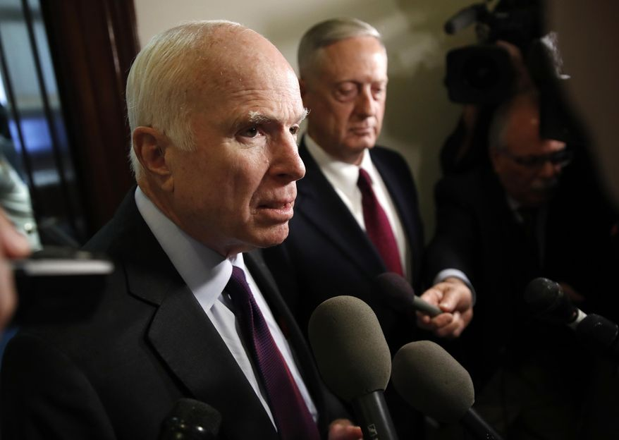 Sen. John McCain, R-Ariz., left, and Defense Secretary James Mattis, speak to members of the media after their meeting Friday, Oct. 20, 2017, on Capitol Hill in Washington. (AP Photo/Jacquelyn Martin)