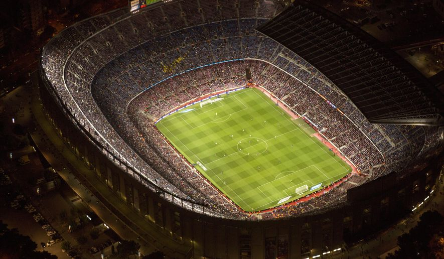 "In this photo dated Tuesday, Sept. 19, 2017, the Camp Nou stadium is seen illuminated ahead of a soccer match between Barcelona F.C and Eibar in Barcelona, Spain, Tuesday, Sept. 19, 2017.  The Camp Nou Stadium in Barcelona is not only one of soccer's biggest and most famous venues but also a tremendous echo chamber for Catalans who want independence from Spain, the rallying cry seeming to become louder than usual with the prosperous region locked in a struggle with the government in Madrid.  When Barcelona plays, fans chant ""Independence!"",  generally 17 minutes and 14 seconds into every match, to mark the year, 1714, when Spain first took away self-rule from Catalonia.(AP Photo/Emilio Morenatti)"