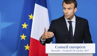 French President Emmanuel Macron speaks during a media conference at the conclusion of an EU summit in Brussels on Friday, Oct. 20, 2017. European Union leaders gathered Friday to weigh progress in negotiations on Britain's departure from their club as they look for new ways to speed up the painfully slow moving process. (AP Photo/Geert Vanden Wijngaert)