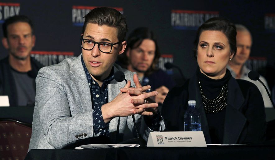 "FILE- In this Dec. 15, 2016, photo, Boston Marathon bombing survivors Patrick Downes, left, and his wife Jessica Kensky address reporters in Boston, during a press availability for ""Patriots Day,"" a movie based on the bombing. Downes and Kensky are awarding a scholarship to a college sophomore who lost a leg to cancer as a child. Jack Manning, of Norfolk, Mass., is the inaugural winner of the ""Boston College Strong"" scholarship being presented Monday, Oct. 23, 2017. (AP Photo/Charles Krupa, File)"