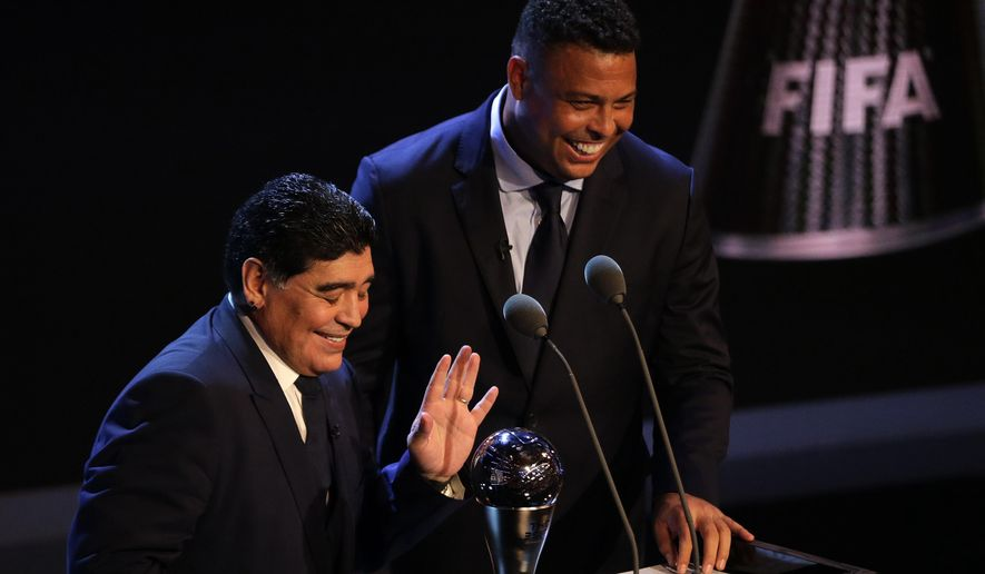 Soccer legends Diego Armando Maradona, left, and Ronaldo laugh as they present the Best FIFA Men's player award during The Best FIFA 2017 Awards at the Palladium Theatre in London, Monday, Oct. 23, 2017. (AP Photo/Alastair Grant)