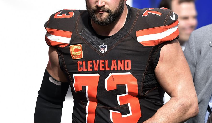 This Sunday, Oct. 22, 2017, photo shows Cleveland Browns tackle Joe Thomas leaving the field after getting hurt in the second half of an NFL football game against the Tennessee Titans, in Cleveland. The Browns are awaiting tests on Pro Bowl tackle Joe Thomas, whose season may be over because of a triceps injury. Thomas was hurt during the third quarter of Sunday's overtime loss to Tennessee, ending his streak of consecutive snaps at 10,363. He had been on the field for every offensive play of his career since 2007 before an injury that left teammates, fans and Titans players shaken. (AP Photo/David Richard)