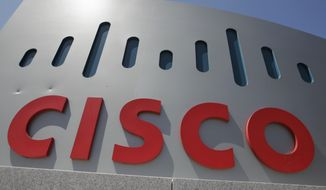 FILE - This Wednesday, May 9, 2012, file photo, shows an exterior view of Cisco Systems Inc. headquarters in Santa Clara, Calif. Cisco is buying BroadSoft for $1.9 billion in a move to bolster telecom technology. The deal is expected to close during the first quarter of 2018. (AP Photo/Paul Sakuma, File)