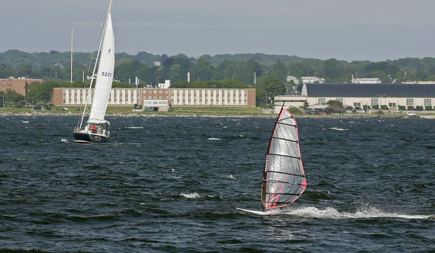 FILE - In this June 12, 2007, file photo, a windsurfer and people aboard a sailboat enjoy the strong winds of Narragansett Bay off the coast of Newport, R.I. The Environmental Protection Agency has canceled the appearance of three scientists at an event on Monday, Oct. 23, 2017, in Rhode Island about a report, which deals in part with climate change. The event is designed to draw attention to the health of the Narragansett Bay. (AP Photo/Stew Milne, File)