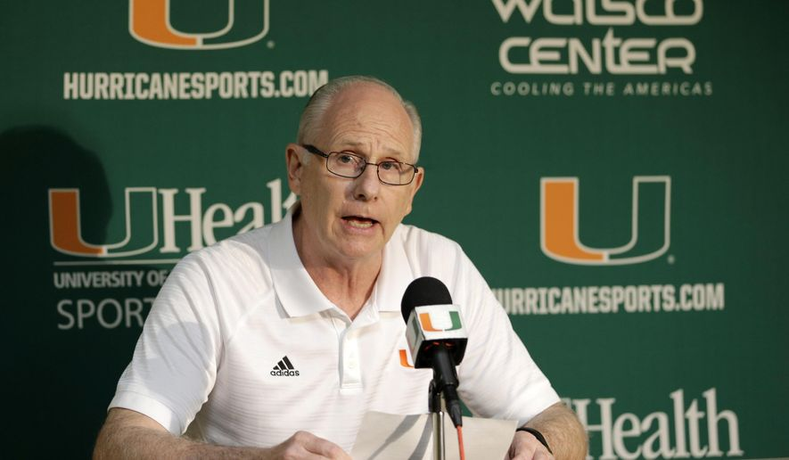 Miami NCAA college basketball head coach Jim Larranaga reads a statement to reporters during a news conference, Monday, Oct. 23, 2017, in Coral Gables, Fla. Miami has been linked to the federal investigation into corruption of college basketball that has rocked the sport, and Larranaga discussed allegations that someone was willing to pay $150,000 to get a recruit to commit to the Hurricanes. Larranaga, through his attorney, has denied any involvement. (AP Photo/Alan Diaz)