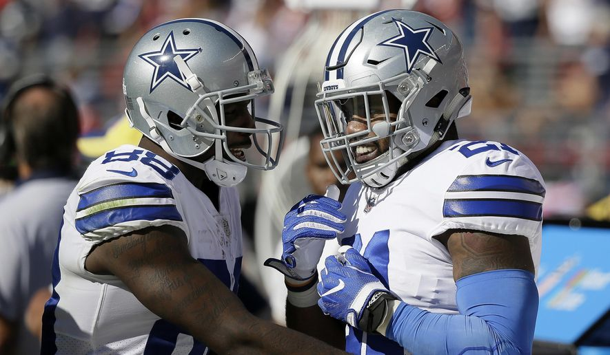 Dallas Cowboys running back Ezekiel Elliott, right, celebrates on the sideline with wide receiver Dez Bryant after scoring a touchdown during the second half of an NFL football game against the San Francisco 49ers in Santa Clara, Calif., Sunday, Oct. 22, 2017. (AP Photo/Eric Risberg)