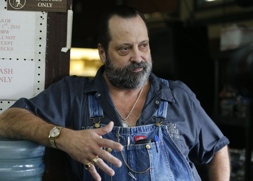 This Monday Oct. 9, 2017 photo shows Pound resident David Williams as he answers a question inside his store during an interview in Pound, Va. People in Virginia's coal country still love President Donald Trump but are unenthusiastic about his pick to be the next governor of Virginia. (AP Photo/Steve Helber)