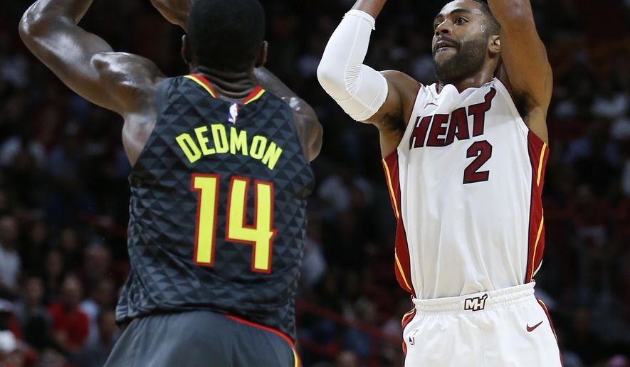 Miami Heat guard Wayne Ellington (2) takes a shot against Atlanta Hawks center Dewayne Dedmon (14) during the first half of an NBA basketball game, Monday, Oct. 23, 2017, in Miami. (AP Photo/Wilfredo Lee)