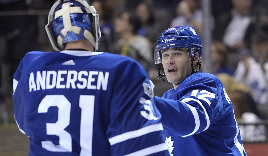 Toronto Maple Leafs center Patrick Marleau (12) and goalie Frederik Andersen (31) celebrate their win over the Los Angeles Kings following an NHL hockey game in Toronto on Monday, Oct. 23, 2017. (Nathan Denette/The Canadian Press via AP)