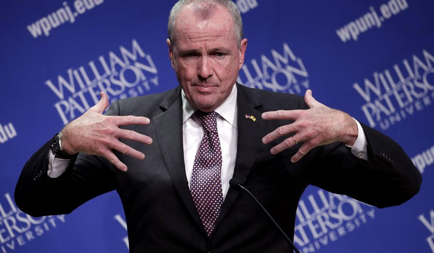 Democratic nominee Phil Murphy talks to reporters after participating in a gubernatorial debate against Republican nominee Lt. Gov. Kim Guadagno at William Paterson University, Wednesday, Oct. 18, 2017, in Wayne, N.J. (AP Photo/Julio Cortez)