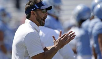 FILE - This Sept. 9, 2017 file photo shows North Carolina head coach Larry Fedora yelling prior to an NCAA college football game against Louisville in Chapel Hill, N.C. Fedora says he isn't making major changes even as the Tar Heels struggle to a 1-7 record. The Tar Heels are coming off the worst loss of the sixth-year coach's tenure at UNC and now face No. 8 Miami on Saturday, Oct. 28, 2017. (AP Photo/Gerry Broome, file)