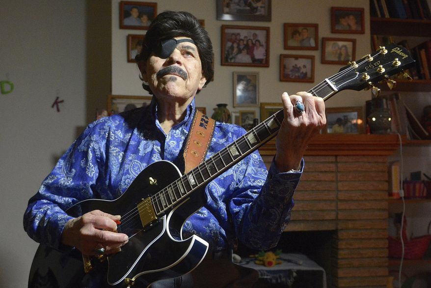 "In this Jan. 14, 2016, photo, Al Hurricane picks some tunes on his guitar in Albuquerque, N.M. Al Hurricane, known as the ""Godfather of New Mexico music"" for developing a distinct sound bridging the state's unique Hispanic traditions with country and rock, died Sunday, Oct. 22. (Greg Sorber/The Albuquerque Journal via AP)"