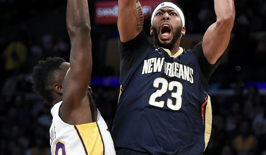 New Orleans Pelicans forward Anthony Davis, right, shoots as Los Angeles Lakers forward Julius Randle defends during the first half of an NBA basketball game in Los Angeles, Sunday, Oct. 22, 2017. (AP Photo/Kelvin Kuo)