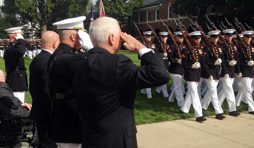 Vice President Mike Pence salutes during a ceremony honoring 241 U.S. Service members killed 34 years ago in the 1983 bombing of the Marine Barracks in Beirut, Lebanon, Monday, Oct. 23, 2017 at the Marine Barracks in Washington. (AP Photo/Ken Thomas)