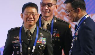 Philippine Armed Forces Chief Gen. Eduardo Ano, left, laughs with Armed Forces spokesman Maj. Gen. Restituto Padilla, right, and Col. Edgard Arevalo, prior to the start of the ASEAN Defense Ministers Meeting Monday, Oct. 23, 2017 in Clark Air Base, Pampanga province, north of Manila, Philippines. Southeast Asian defense ministers opened their annual meeting on Monday, with counter-terrorism strategies high on the agenda. (AP Photo/Bullit Marquez)
