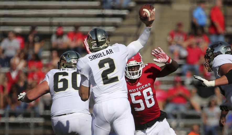 Rutgers' Kemoko Turay (58) pressures Purdue quarterback Elijah Sindelar during an NCAA college football game, Saturday, Oct. 21, 2017, in Piscataway, N.J. (John Munson/NJ Advance Media via AP)