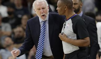 San Antonio Spurs head coach Gregg Popovich, left, argues a call during the first half of an NBA basketball game against the Toronto Raptors, Monday, Oct. 23, 2017, in San Antonio. (AP Photo/Eric Gay)