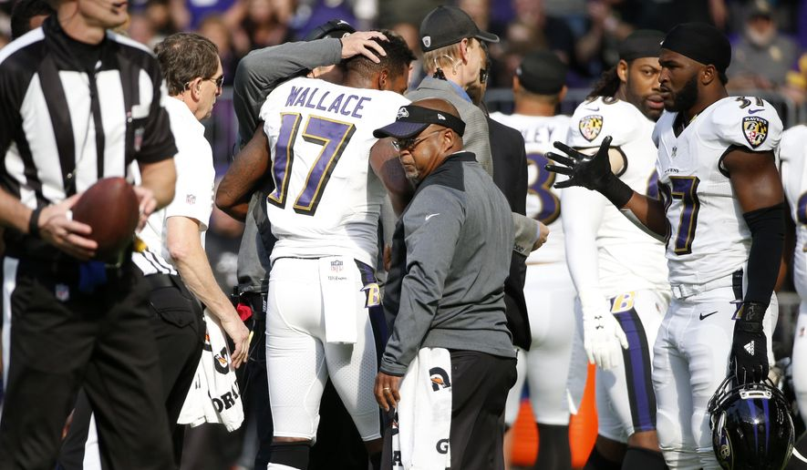 FILE - In this Oct. 22, 2017, file photo, Baltimore Ravens wide receiver Mike Wallace (17) is helped off the field after getting injured during the first half of an NFL football game against the Minnesota Vikings, in Minneapolis. The injuries and losses are piling up for the Ravens, who have dropped four of five and need to regroup before facing the Miami Dolphins on Thursday night.(AP Photo/Bruce Kluckhohn, File)