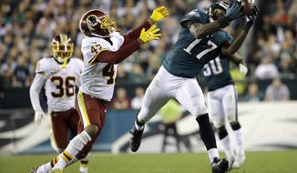 Philadelphia Eagles wide receiver Alshon Jeffery (17) makes a catch as Washington Redskins cornerback Quinton Dunbar (47) defends during the second half of an NFL football game, Monday, Oct. 23, 2017, in Philadelphia. (AP Photo/Michael Perez)