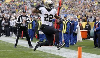 New Orleans Saints running back Mark Ingram (22) leaps into the end zone for a touchdown during the first half of an NFL football game against the Green Bay Packers, Sunday, Oct. 22, 2017, in Green Bay, Wis. (AP Photo/Jeffrey Phelps)