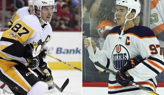 FILE - At left, in an Oct. 11, 2017, file photo, Pittsburgh Penguins center Sidney Crosby plays against the Washington Capitals during the first period of a NHL hockey game, in Washington. At right, in an Oct. 21, 2017, file photo, Edmonton Oilers' Connor McDavid skates prior to the start of an NHL hockey game against the Philadelphia Flyers, in Philadelphia. Connor McDavid grew up idolizing Sidney Crosby. The 20-year-old McDavid will get an up close look on Tuesday, Oct. 24, when the NHL's two biggest stars share the ice as McDavid and the Oilers visit Crosby and the Penguins. (AP Photo/File)