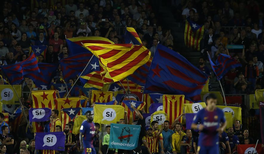 FC Barcelona supporters wave Esteladas, Catalan pro-independence flags, during the Spanish La Liga soccer match between FC Barcelona and Malaga at the Camp Nou stadium in Barcelona, Spain, Saturday, Oct. 21, 2017. (AP Photo/Manu Fernandez)