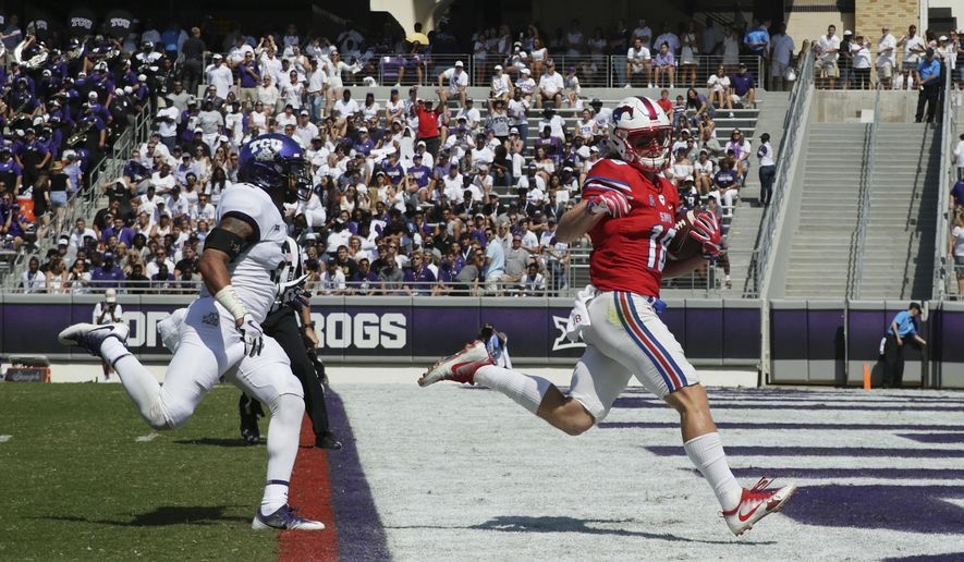 FILE - This Sept. 16, 2017 file photo shows SMU wide receiver Trey Quinn (18) beating TCU safety Niko Small (2) to the end zone for a touchdown reception during the first half an NCAA college football game in Fort Worth, Texas. SMU has completed 94 passes over the last three games. Trey Quinn has been on the receiving end of 49. (AP Photo/LM Otero)