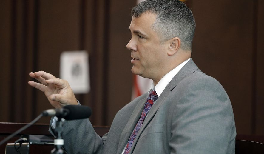 Nashville Police Detective Steve Jolley testifies during a preliminary hearing for Emanuel Kidega Samson in general sessions court Monday, Oct. 23, 2017, in Nashville, Tenn. Samson is accused of fatally shooting one person and wounding others at a Tennessee church on September. Jolley said Samson told him he heard voices and had visions. Jolley also testified about a note in Samson's car that referenced a white supremacist's 2015 massacre at a South Carolina black church. The case against Samson was bound over to a grand jury. Samson did not appear at the hearing. (AP Photo/Mark Humphrey)