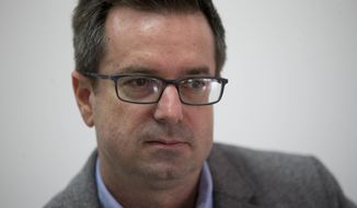 In this Oct. 20, 2017 photo, Scott Smith poses for a portrait in the office of the Associated Press in Caracas, Venezuela. The AP has named Smith as its new correspondent in Caracas. The cross-format journalist from California joins a staff of award-winning journalists covering one of the world's most complex stories. (AP Photo/Ariana Cubillos)