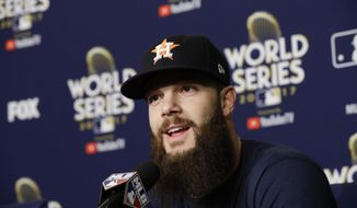 Houston Astros starting pitcher Dallas Keuchel talks during a news conference during media day for baseball's World Series against the Los Angeles Dodgers, Monday, Oct. 23, 2017, in Los Angeles. (AP Photo/David J. Phillip)