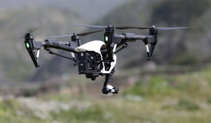 In this March 10, 2015, file photo, The Inspire 1, a drone manufactured by DJI, is flown in Davenport, Calif. Mexico published rules governing the use of drones on Wednesday, April 29, 2015, allowing people to operate the smallest drones in daylight without a permit but with safety rules. (AP Photo/Marcio Jose Sanchez, File)